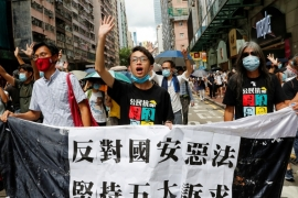 Protesters in Hong Kong march on the anniversary of the city's handover to China from Britain [Tyrone Siu/Reuters]