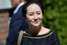 Huawei Technologies Chief Financial Officer Meng Wanzhou leaves her home to attend a court hearing in Vancouver, British Columbia, Canada in May [File: Jennifer Gauthier/Reuters]