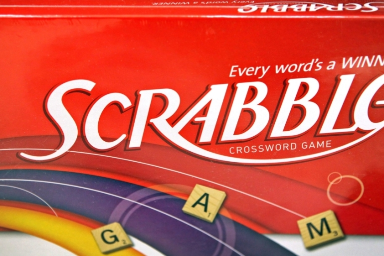Hasbro, the American toy company which owns the trademark for the board game, has not allowed offensive slurs in Scrabble's dictionary since 1994 but technically does not control the 200,000 playable words used by the North American association [File: Tim Boyle/Bloomberg]