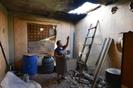 A local woman shows the damage in her house after shelling by Azerbaijan forces in the Aygepar village in Armenia's Tavush region [Karo Sahakyan/PAN Photo via AP]