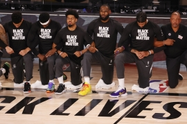 Player and coaches from Los Angeles Lakers and Los Angeles Clippers took a knee during the national anthem [Erik S Lesser/EPA]