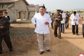 Kim Jong Un visits a poultry farm under construction earlier this month; North Korea's economy grew in 2019 for the first time in three years [KCNA via Reuters]