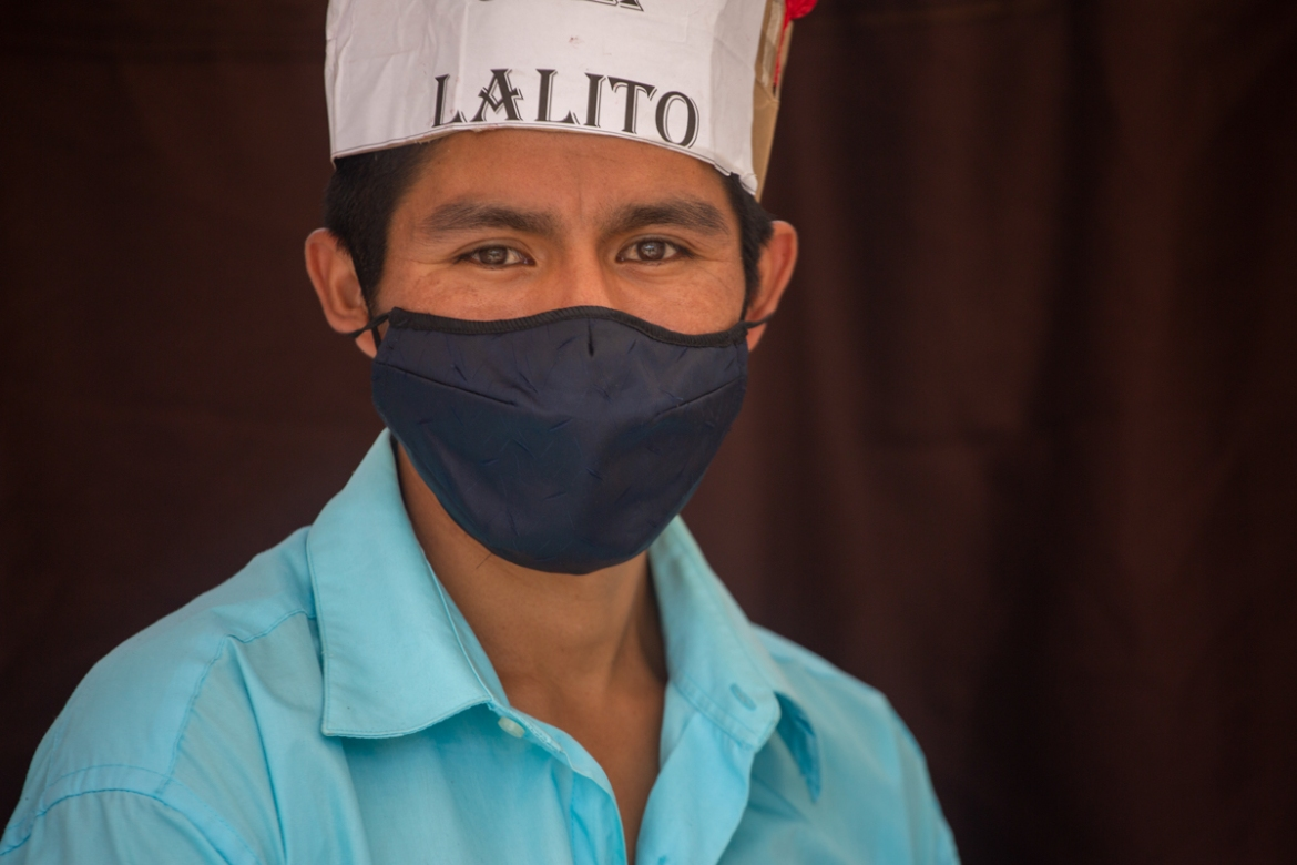Guatemalan teacher Gerardo Ixcoy, wearing a protective face mask, found a way to give individual instruction to his sixth-grade students amid the new coronavirus pandemic. [Moises Castillo/AP Photo]
