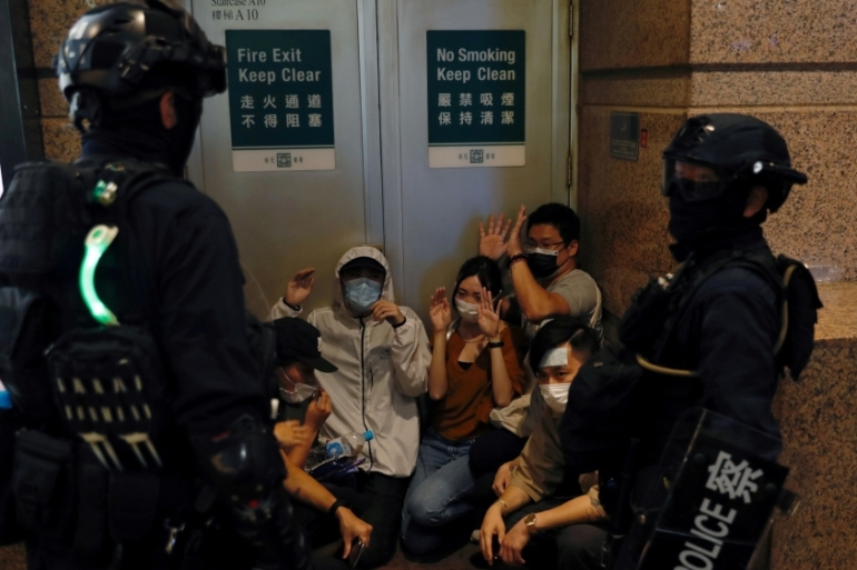 Riot police detain people during a march against Hong Kong's new national security law on July 1, 2020 [File: Tyrone Siu/Reuters]