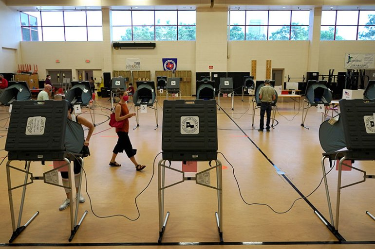Voters cast their ballots on Tuesday in Houston, Texas, a previously solid Republican state that has become more competitive as US President Donald Trump suffers in the polls [David J Phillip/AP Photo]