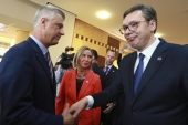 Kosovo President Hashim Thaci shakes hands with Serbian President Aleksandar Vucic in front of EU foreign policy chief Federica Mogherini in Tirana on May 9, 2019 [File: AP/Hektor Pustina]