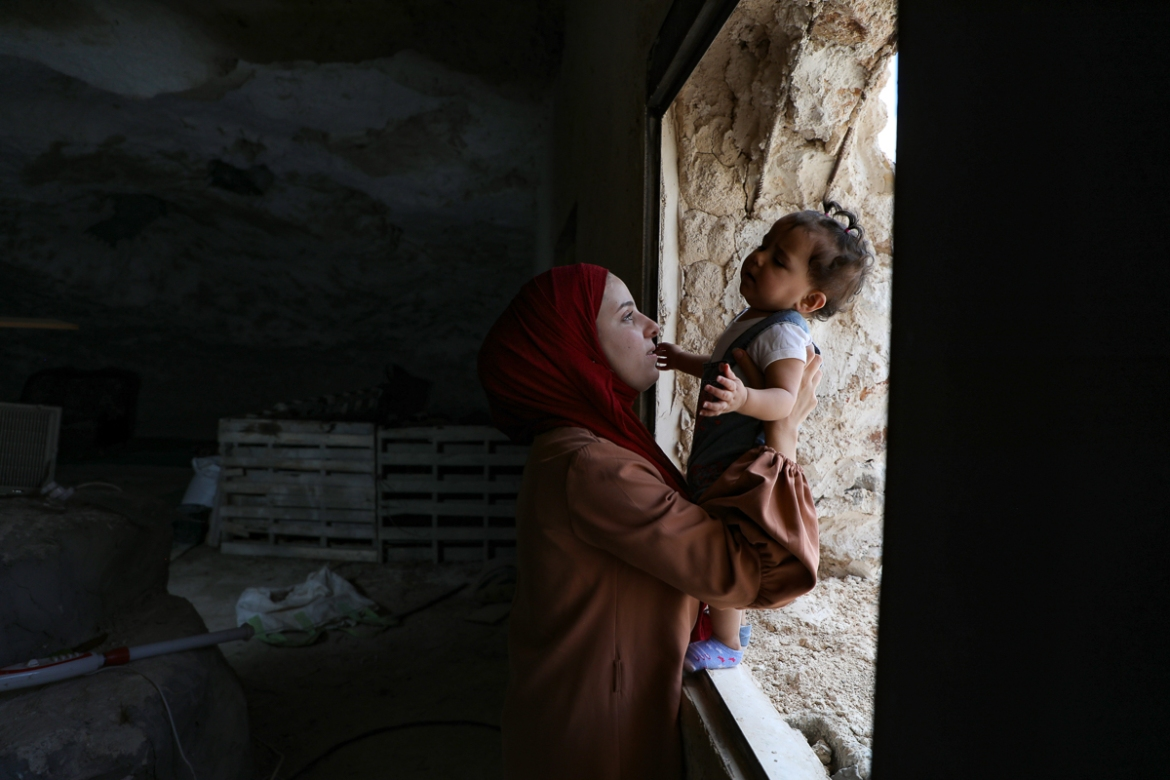 After a year and a half living in the cave, Amarneh and his family received a demolition notice from the Israeli authorities in July, along with 20 other Palestinian families in Farasin. [Jaafar Ashtiyeh/AFP]