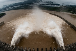 The Three Gorges Dam on the Yangtze River discharges water to lower the water level in the reservoir following heavy rainfall in July [China Daily via Reuters]
