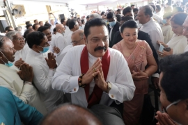 Mahinda Rajapaksa assumed charge as Sri Lanka's prime minister on Wednesday [Dinuka Liyanawatte/Reuters]