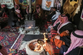 Syrian Bedouins roast coffee beans in a camp during a gathering near the town of Hamouria, in the eastern Ghouta region, near the capital Damascus on February 8, 2017 [File: AFP/Amer Almohibany]