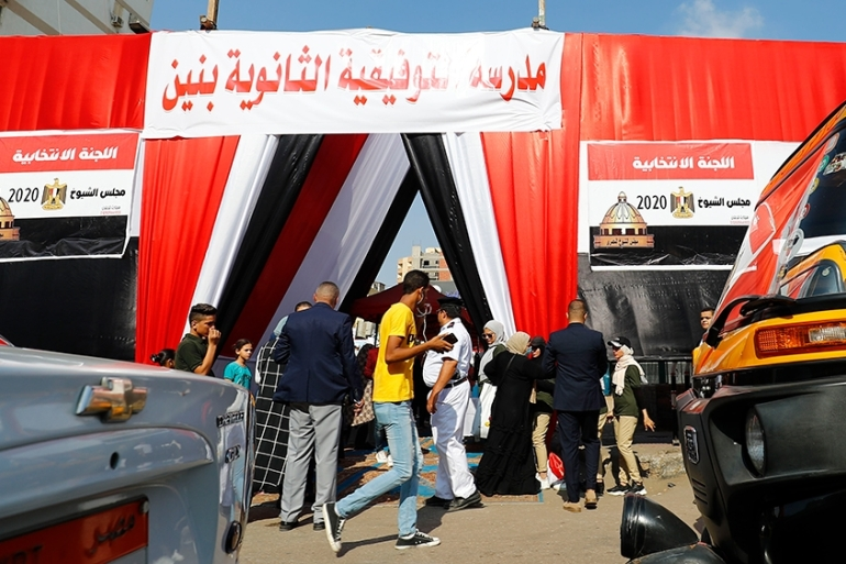 Egyptians queue up to vote outside a polling station for a new Senate in an upper house election [Khaled Desouki/AFP]