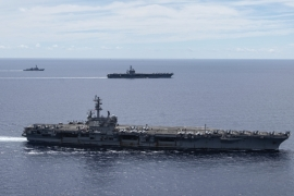 In this photo provided by the US Navy, the USS Ronald Reagan sails in the South China Sea on July 6, 2020 [US Navy via AP]