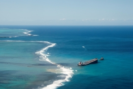 Bulk carrier ship MV Wakashio ran aground on a reef, at Riviere des Creoles, Mauritius, on July 25, 2020 [File: Reuters/French Army command/Handout]