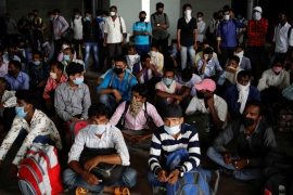 Hundreds of migrant workers from the countryside who had left New Delhi in droves after losing their jobs in a nationwide lockdown in March returned in buses on Monday. [Adnan Abidi/Reuters]