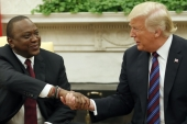 In this August 27, 2018 file photo US President Donald Trump is seen shaking hands with his Kenyan counterpart, Uhuru Kenyatta, in the Oval Office of the White House [AP Photo/Alex Brandon]