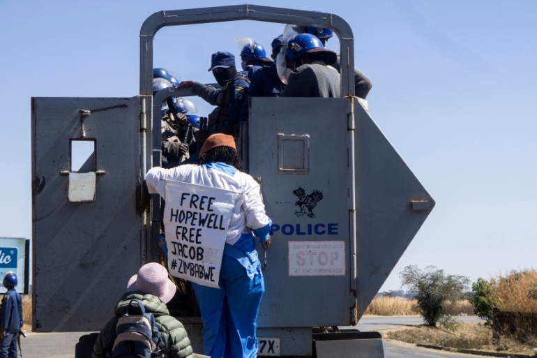 Dangarembga was bundled into a police truck as she demonstrated in the Harare suburb of Borrowdale [AFP]