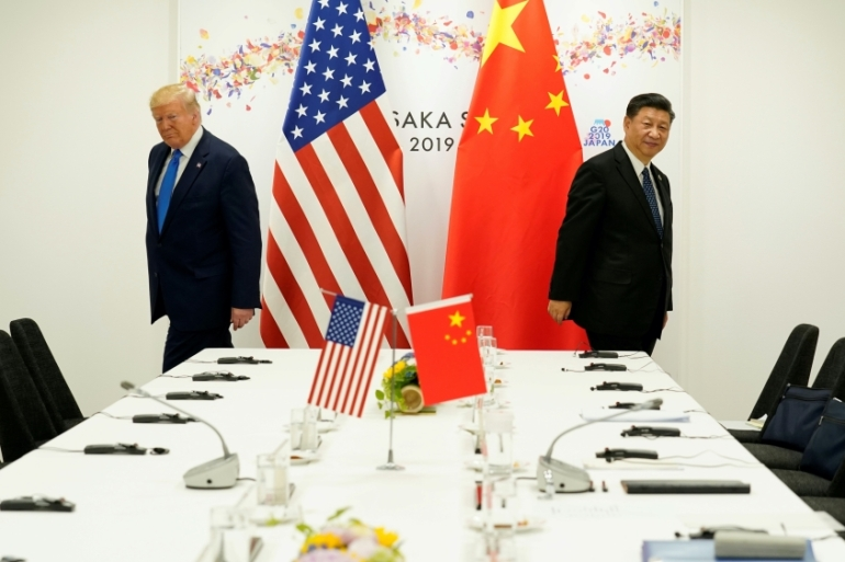 US President Donald Trump attends a bilateral meeting with Chinese President Xi Jinping during the G20 leaders' summit in Japan, 2019 [File: Kevin Lamarque/Reuters]