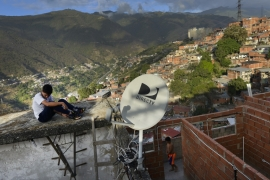 A DirecTV dish on a home in Caracas, Venezuela, where the company abruptly ditched its popular satellite TV service on May 19, citing US sanctions that banned it from broadcasting channels required by Maduro's administration  [File: Matias Delacroix/AP Photo]