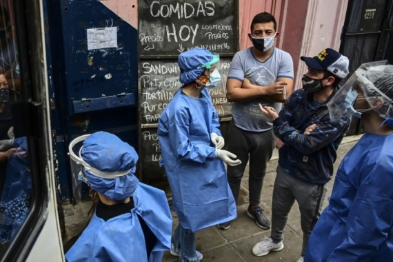 Argentinian dentists work as volunteers to detect COVID-19 cases in Buenos Aires [Ronaldo Schemidt/AFP]