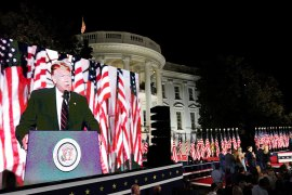 US President Donald Trump is projected on a screen on the South Lawn of the White House as he delivers his acceptance speech as the 2020 Republican presidential nominee during the final event of the Republican National Convention in Washington, DC, on August 27, 2020 [Kevin Lamarque/Reuters]