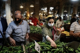 People wearing masks to help prevent the spread of the coronavirus shop at the grand bazaar of Zanjan, some 330km (205 miles) west of the capital Tehran, Iran (AP Photo/Vahid Salemi) [The Associated Press]