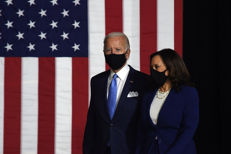 Democratic presidential nominee and former US Vice President Joe Biden (L) and vice presidential running mate, US Senator Kamala Harris, arrive to conduct their first press conference together in Wilmington, Delaware, on August 12, 2020. (Photo by Olivier DOULIERY / AFP) [AFP]