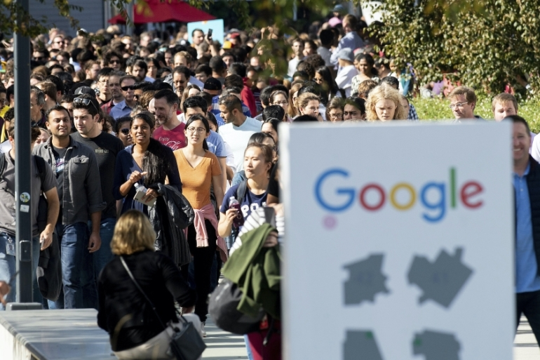 Employees are seen as they leave Google's global headquarters in Mountain View, California on November 1, 2018 [AP Photo/Noah Berger]