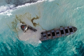 This aerial picture taken on August 16 shows the MV Wakashio bulk carrier that had run aground and broken into two parts near Blue Bay Marine Park. [AFP]