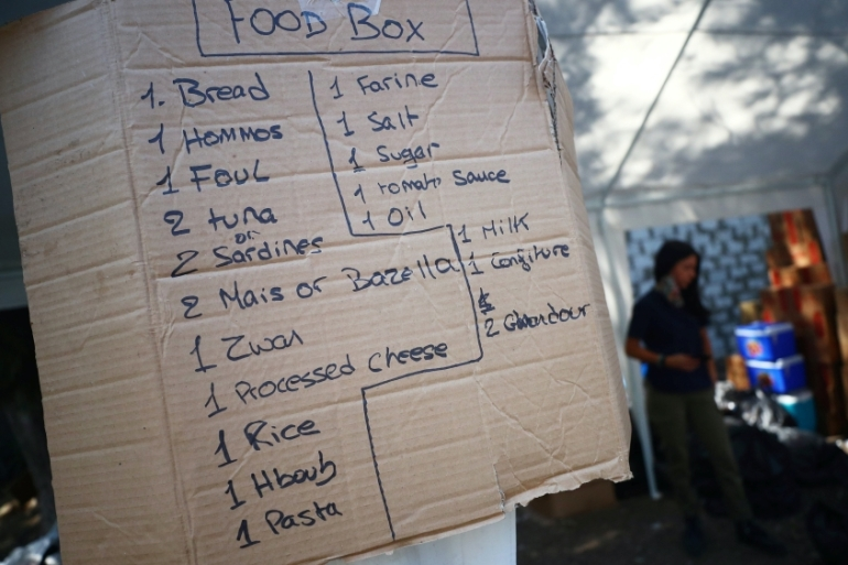 A sign listing the items of food required to make up a food box for people in need is seen in a volunteer base camp in Beirut, Lebanon, where much of the economy has been paralysed by the worst financial crisis in the country's history [File: Hannah McKay/Reuters]
