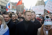 Russian opposition leader Alexey Navalny and his wife Yulia take part in a rally to mark the 5th anniversary of Boris Nemtsov's murder in Moscow on February 29, 2020 [File: Reuters/Shamil Zhumatov]