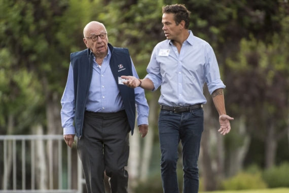 Lachlan Murdoch (right) is poised to take the reins of the family's media empire from his father and media mogul Rupert (left), aged 89, when the time comes [File: David Paul Morris/Bloomberg]