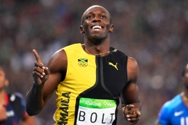 Bolt is the only sprinter to win the 100m and 200m golds at three consecutive Olympics [File: Franck Robichon/EPA]
