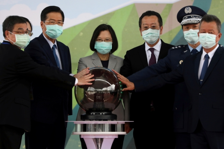 Taiwan President Tsai Ing-wen, centre, attends an inauguration ceremony of a maintenance centre for F-16 fighter jets, in Taichung, Taiwan [Ann Wang/Reuters]