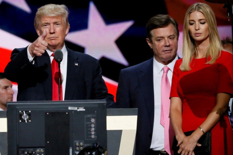 Manafort, centre, was convicted as part of the special counsel probe into Russian meddling in the 2016 US election [File: Rick Wilking/Reuters]