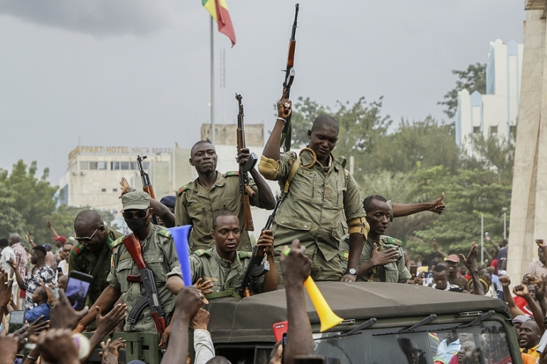 epa08611367 Malians cheer as Mali military enter the streets of Bamako, Mali, 18 August 2020. Local reports indicate Mali military have seized Mali President Ibrahim Boubakar KeÔta in what appears to be a coup attempt.  EPA-EFE/MOUSSA KALAPO [EPA]