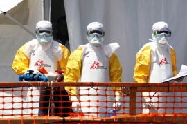 Health workers dressed in protective suits are seen at the Doctors Without Borders Ebola treatment centre in Goma, DRC [File: Baz Ratner/Reuters]