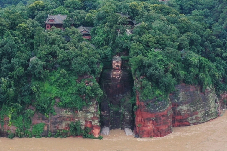 Floodwater lapped the feet of the Leshan Giant Buddha after heavy rains that triggered flooding and forced evacuations [China Daily via Reuters]