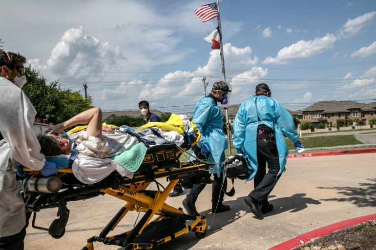 Medics with Austin-Travis County EMS transport a nursing home resident with coronavirus symptoms on August 03, 2020 in Austin, Texas. Texas has had the third-highest number of COVID-19 cases in the United States, following Florida and California. John Moore/Getty Images/AFP JOHN MOORE / GETTY IMAGES NORTH AMERICA / Getty Images via AFP [AFP]