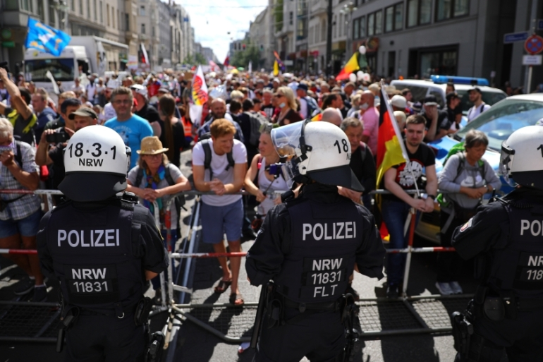 Thousands of people protest against coronavirus-related restrictions and government policy in Berlin [Omer Messinger/Getty Images]