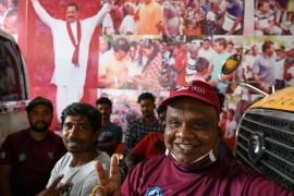 Supporters of Prime Minister Mahinda Rajapaksa celebrate election win near his home in the southern town of Tangalle [Lakruwan Wanniarachchi/AFP]
