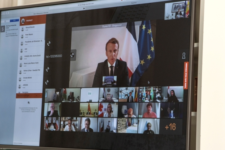 French President Emmanuel Macron (on screen) participates via a video connection with world leaders about aid to Lebanon [EPA]