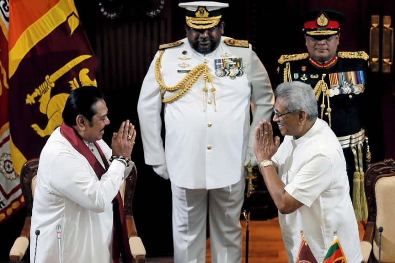 Critics fear the planned constitutional reform will led to authoritarianism, as it will amass more power in the hands of President Gotabaya Rajapaksa (right) [File: Dinuka Liyanawatte/Reuters]