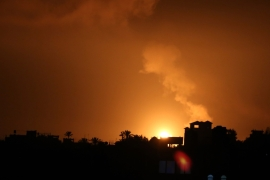 Explosion illuminates the night sky after Israeli warplanes hit several posts belonging to the Hamas government in the Gaza Strip [Anadolu Agency]