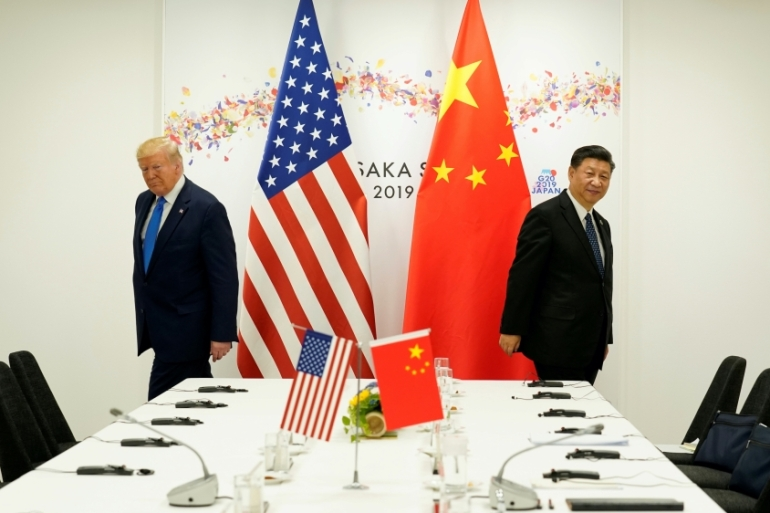 US President Donald Trump attends a bilateral meeting with China's President Xi Jinping during the G20 leaders summit in Osaka, Japan, June 2019 [File: Kevin Lamarque/Reuters]