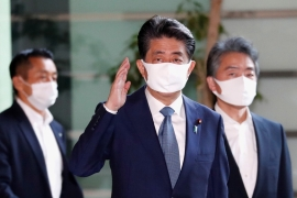 Suffering from poor health, Japan's Prime Minister Shinzo Abe arrives at his official residence on Friday [Issei Kato/Reuters]