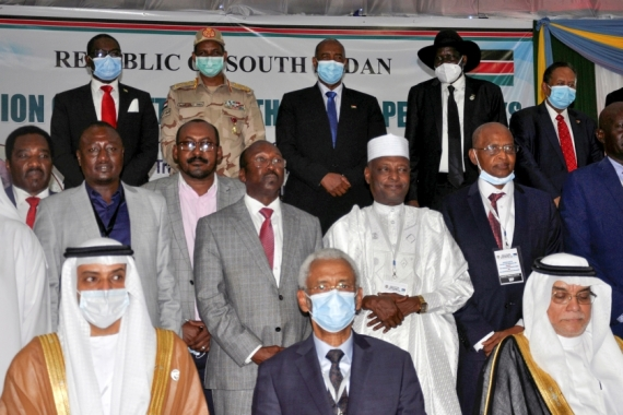 Delegates pose for a photograph during the signing of a peace agreement between Sudan's power-sharing government and five key rebel groups in Juba, South Sudan [File: Samir Bol/Reuters]