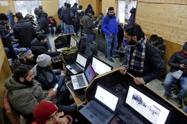 Journalists were forced to visit a government-run media centre in Srinagar to access internet [File: Danish Ismail/Reuters]