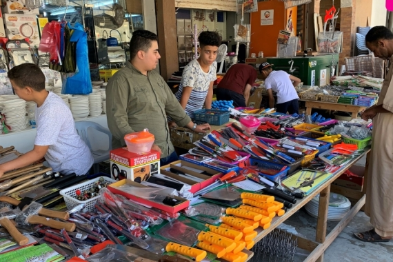 A vendor sells knives at a market before the Eid al-Adha celebrations, amid the coronavirus pandemic, in Misrata, Libya, which slipped into chaos after the NATO-backed overthrow of Gaddafi [File: Ayman Al-Sahili/Reuters]