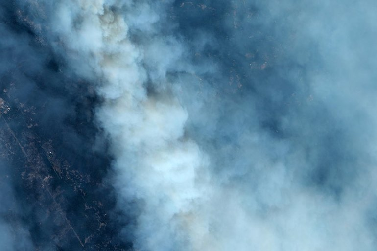 Smoke covers the California landscape in this satellite image of the CZU Lightning Complex wildfire over Santa Cruz, California on August 21, 2020 [Maxar Technologies/Handout via Reuters]