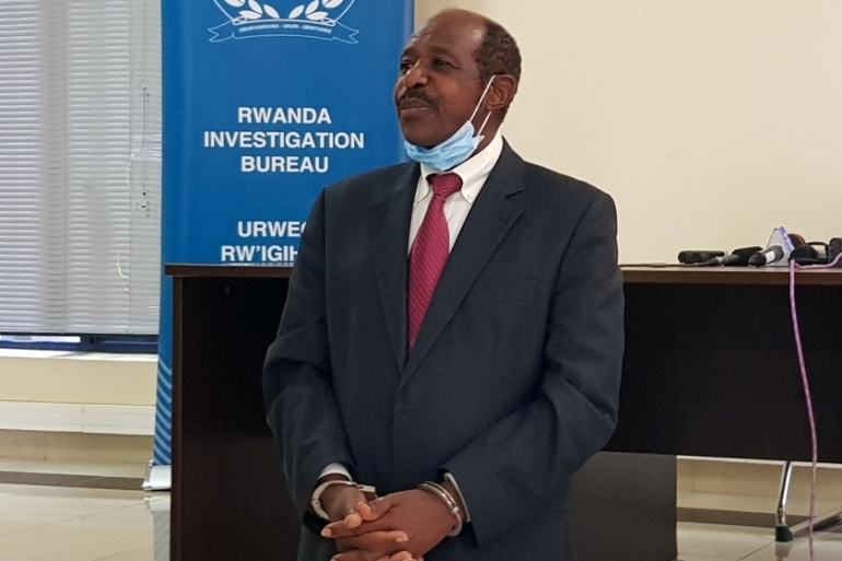 Paul Rusesabagina was paraded in front of media in handcuffs at the headquarters of Rwanda Investigation Bureau in Kigali [Clement Uwiringiyimana/Reuters]